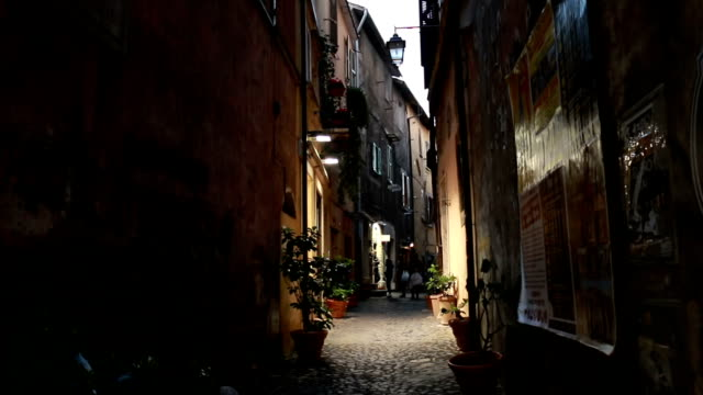 Small Italian old town street at dusk video