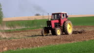 small old agriculture tractor cultivated field video