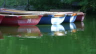 Small rowing boats floating on lake, copy space, HD video