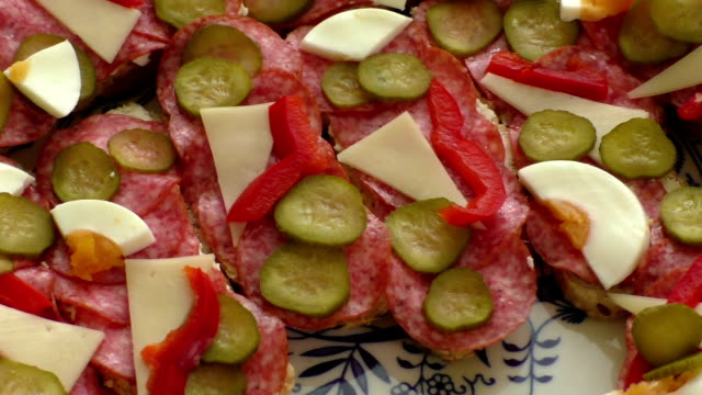 Small snacks canape with salami, cheese and pickle video