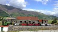 Small steam train in mountain scenery video