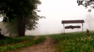 Small town sign in the foggy forest video