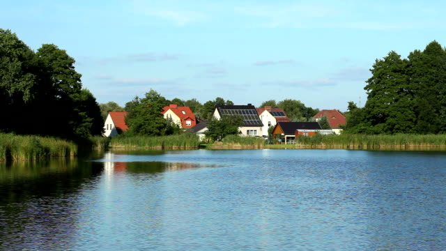 Small village by lake, roof with solar energy video