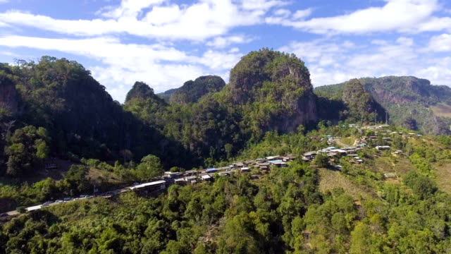 Small village on the edge of mountain with beautiful peak in the morning, Fly with drone video