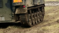 Smaller tank splashing in the mud video
