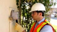 Smart Meter Installer Technician Calibrates Device video