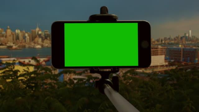 Smart phone chromakey green screen New York City selfie stick video