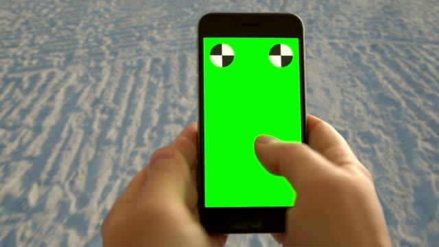 Smart phone chromakey green screen texting surfing net Florida beach video