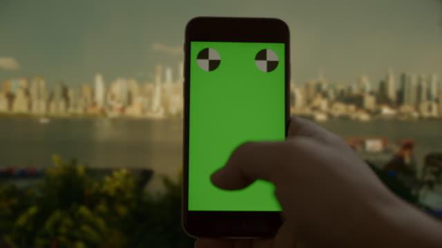 Smart phone chromakey green screen texting surfing New York City video