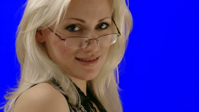 Smart sexy flirting woman on chroma key video