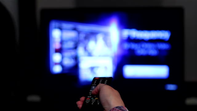 Smart tv and young woman hand pressing remote control video