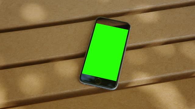 Smartphone bench shadow green screen chromakey mobile video