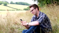 Smartphone man, country style. video