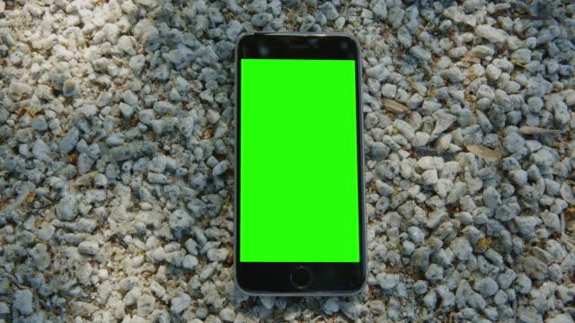 Smartphone mobile white stone sun reflection chromakey green screen video