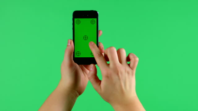 Smartphone tap, swipe, spread and pinch hand gestures on green screen video