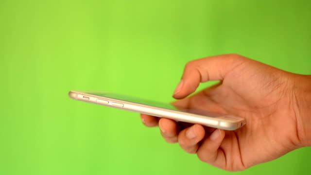 Smartphone touchscreen on green screen video