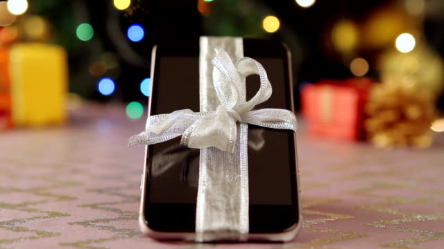 Smartphone with Christmas gifts and decorations video