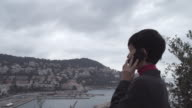 Smartphone woman talking on phone.Autumn cloudy day video