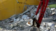 Smashing concrete and disposal of construction building pet shop waste with heavy machinery video