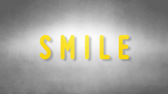 Smile headband. Text from sand. With black background video