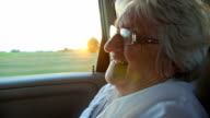 Smile senior women in the car at sunset video