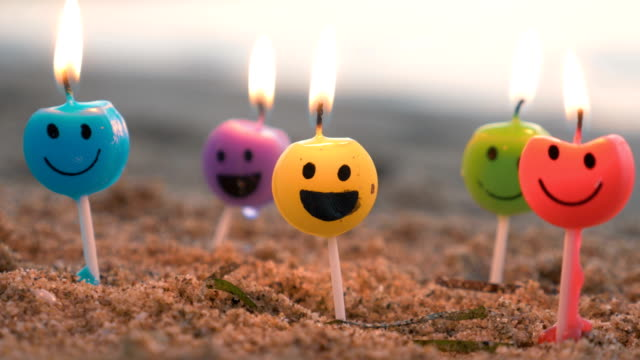 Smiley candles on the beach video