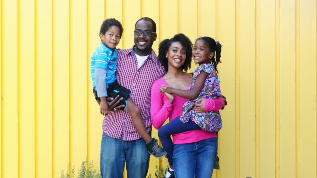 Smiling and Happy Black African American Family Group Portrait video