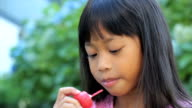 Smiling Asian Girl Enjoys A Popsicle-Close Up video