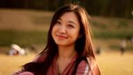 smiling Asian girl video