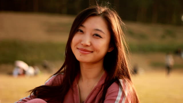 smiling Asian girl video