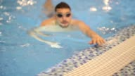 Smiling athletic swimmer at swimming pool video