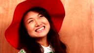 Smiling attractive hipster wearing hat video