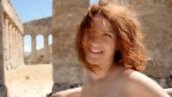 smiling beautiful woman near greek temple in Sicily: Italian, summer, sun, heat video