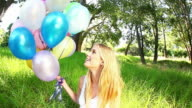 Smiling Beautiful Woman With Balloons. Fisheye-shot video