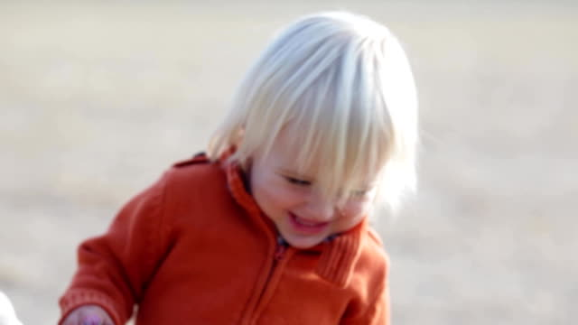 Smiling blond child play outdoor in winter time video