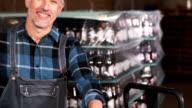 Smiling brewery worker preparing orders video