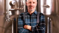 Smiling brewery worker with thumbs up video