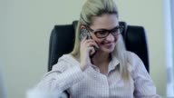 Smiling businesslady talking over mobile phone video