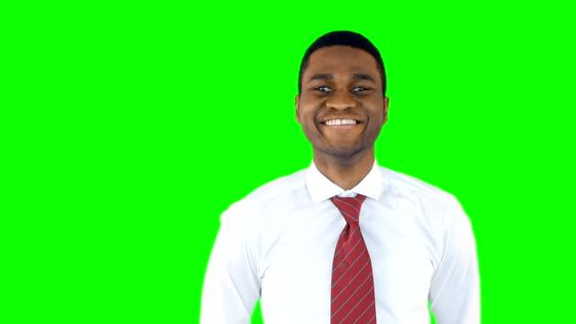 Smiling businessman looking at camera video