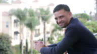 smiling businessman outdoors video
