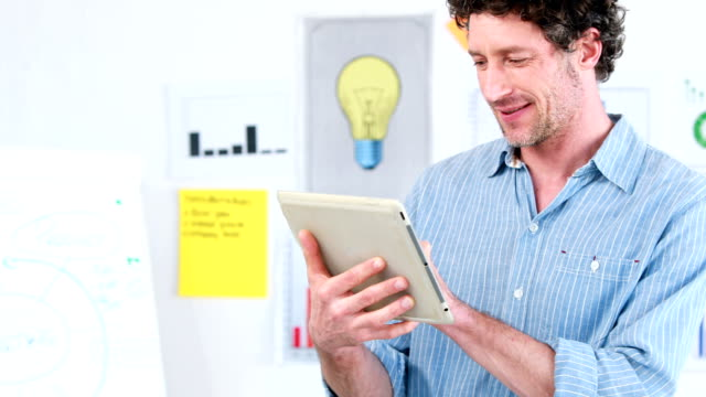 Smiling businessman using a tablet video