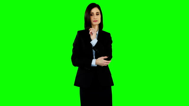 Smiling businesswoman pointing at screen video