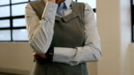 Smiling businesswoman talking on the phone video