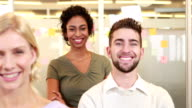 Smiling casual business team posing video