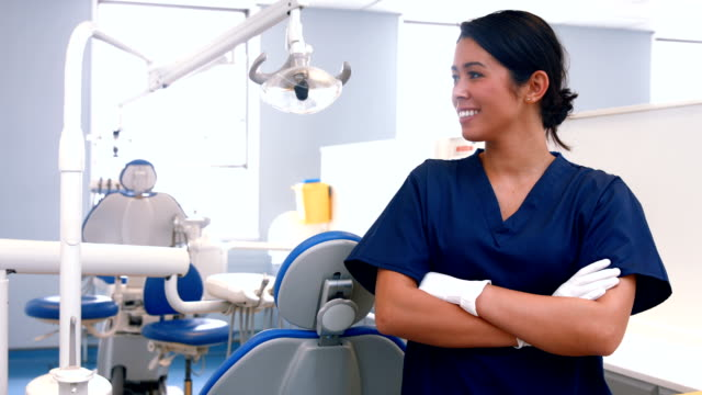 Smiling dentist by her equipment video