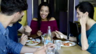 Smiling friends eating together video