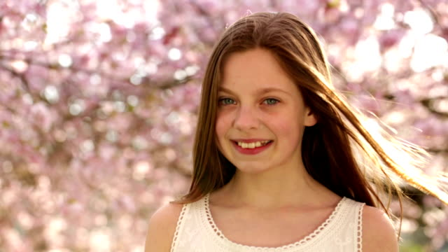Smiling girl looking at camera during spring video