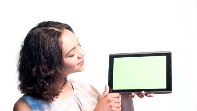 Smiling girl showing on her tablet video