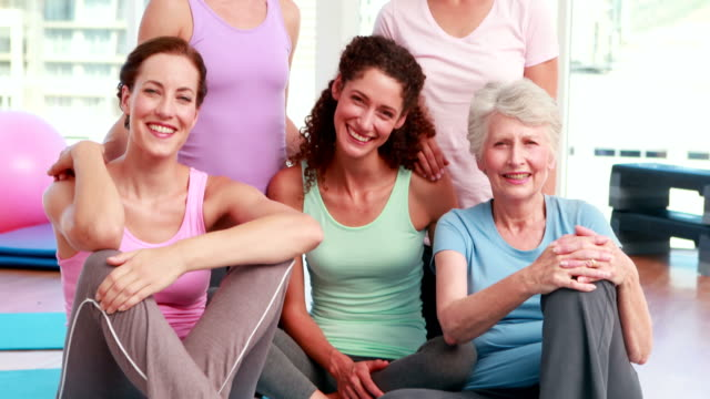 Smiling group of women in fitness studio video