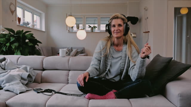 Smiling happy woman relaxing to music video